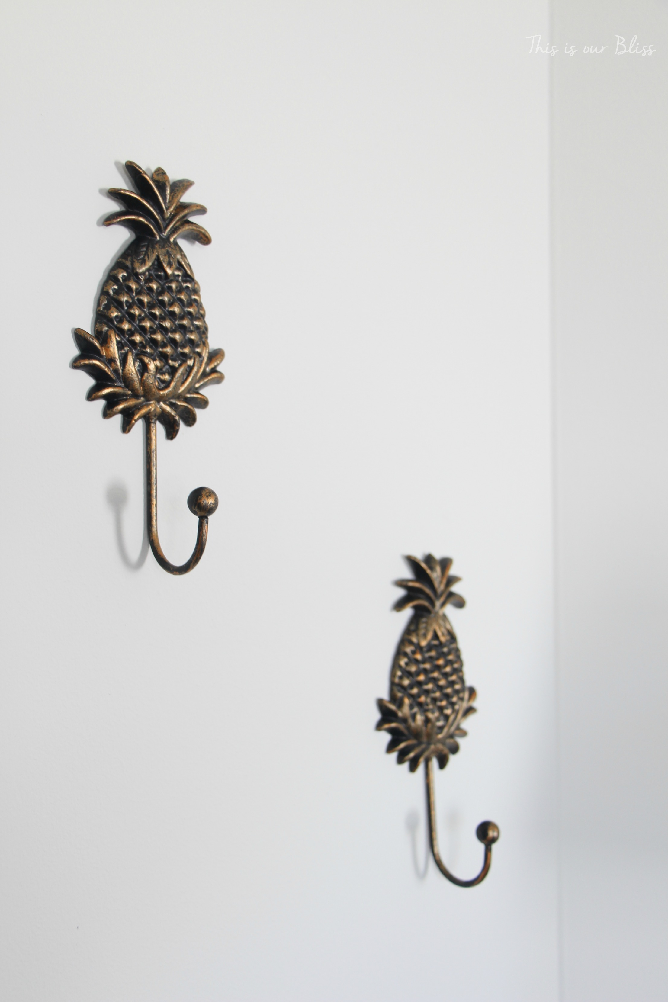 gold pineapple wall hooks - guestroom revamp - This is our Bliss