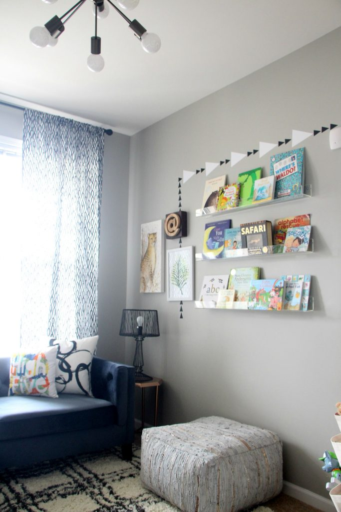 Stylish and Bold Modern Playroom | Eclectic Modern Safari space for kids | Neutral decor with pops of color | Acrylic bookshelves | This is our Bliss