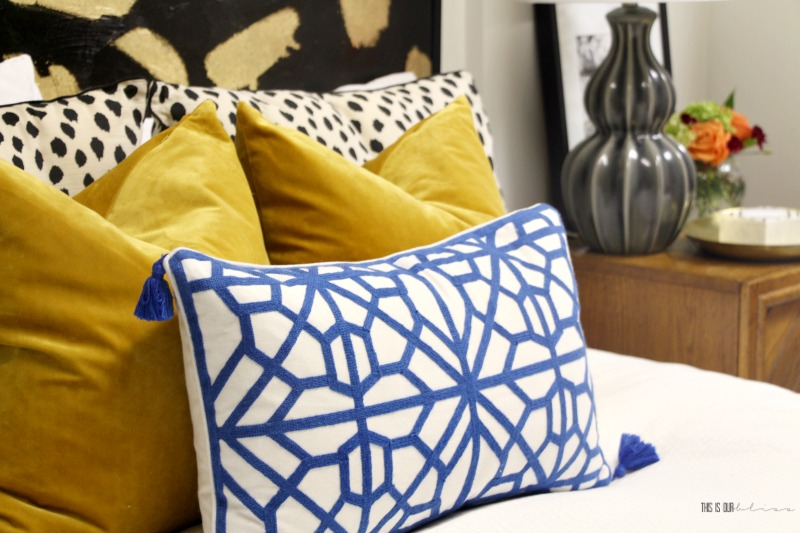 Basement Guestroom Reveal - Pattern play on the bed with bold colors - $100 Room Challenge - This is our Bliss