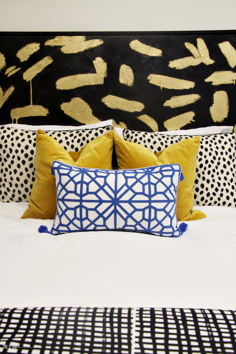 Basement Guestroom Reveal - colorful pillows with pattern play - $100 Room Challenge - This is our Bliss
