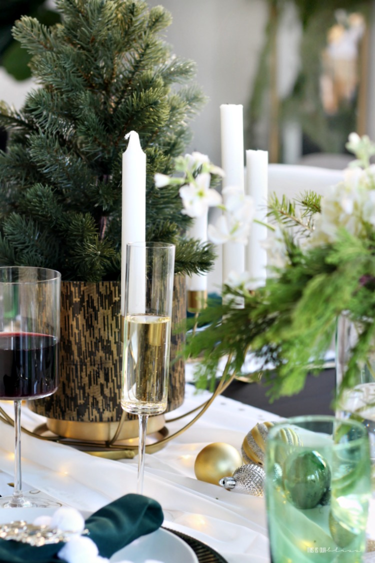 Christmas Tablescape - holiday hosting with wine fresh flowers and green white and gold placesettings - This is our Bliss