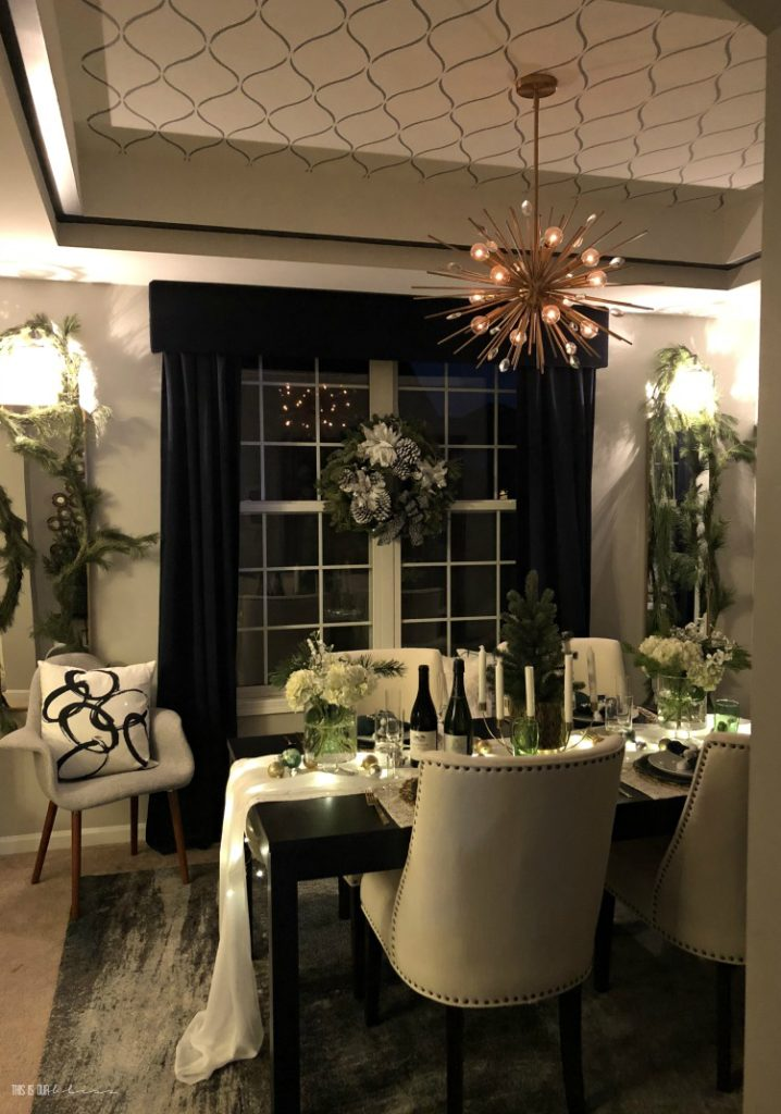 Fresh & Festive Christmas Dining Room at night - Sconces and chandelier in the dining room for Christmas hosting and entertaining - This is our Bliss