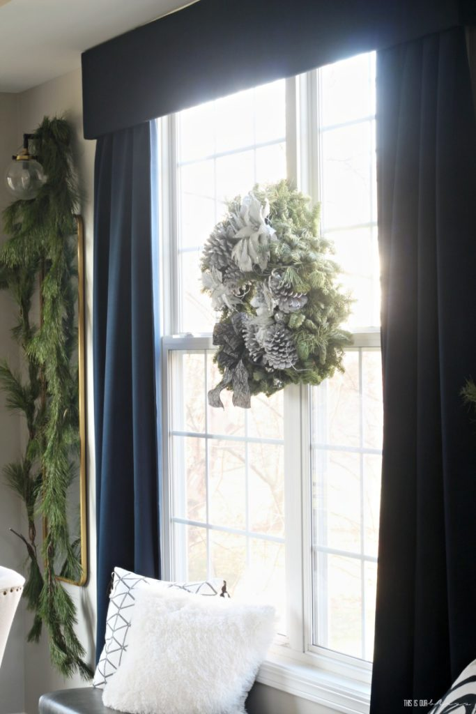 Fresh and Festive Christmas Dining Room - gold mirrors with fresh garland on dining room windows - This is our Bliss
