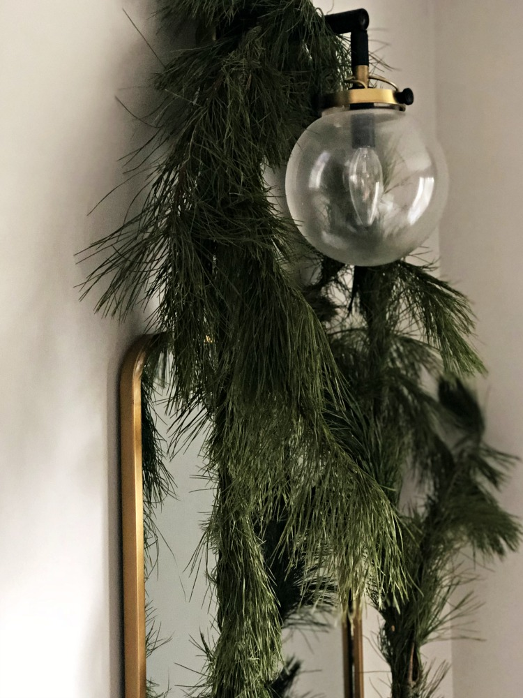 Fresh garland on Dining Room Sconces and wall mirrors - Fresh and Festive Christmas Dining Room