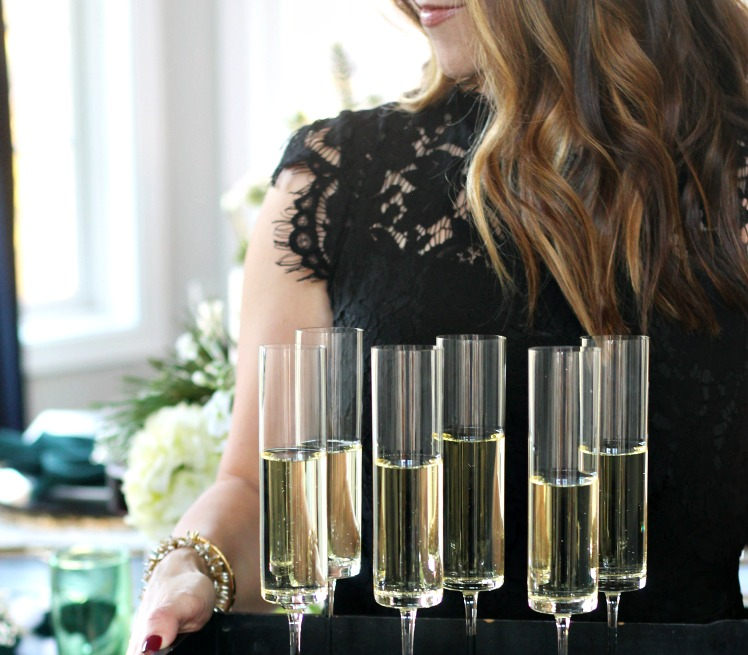 LBD with champagne flutes - the perfect little black dress for the holidays - This is our Bliss