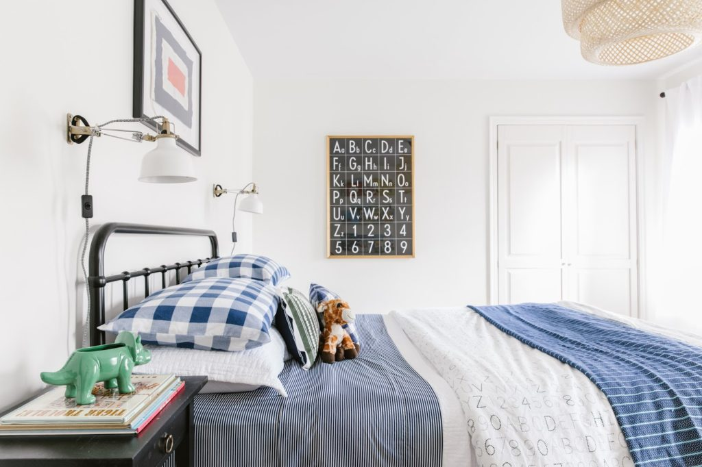 big boy room with blue bedding and black and white wall art