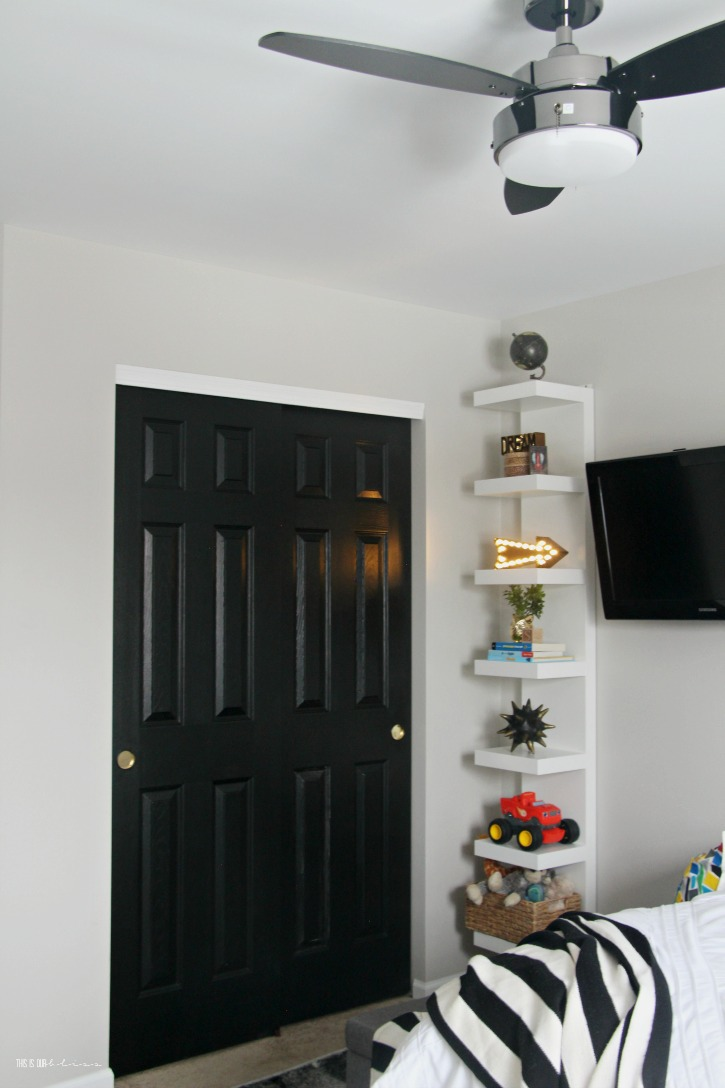 Big Boy Room Reveal with color pattern and bold black accents - floating wall shelf in a boy room - This is our Bliss