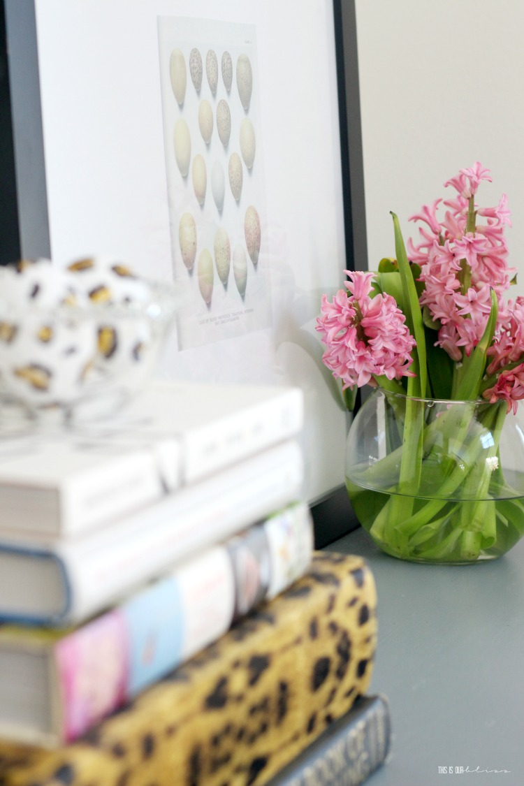 A Touch of Spring in the entryway - pink hyacinth flowers in a vase - This is our Bliss