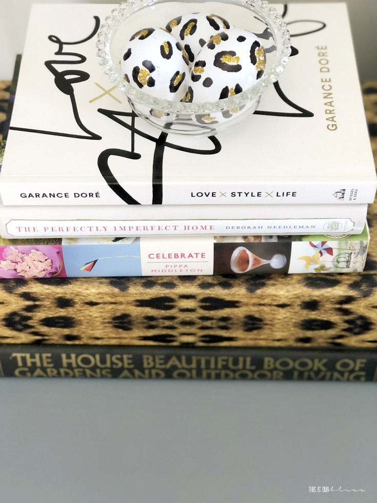 A Touch of Spring in the entryway - simple stacked coffee table books - This is our bliss