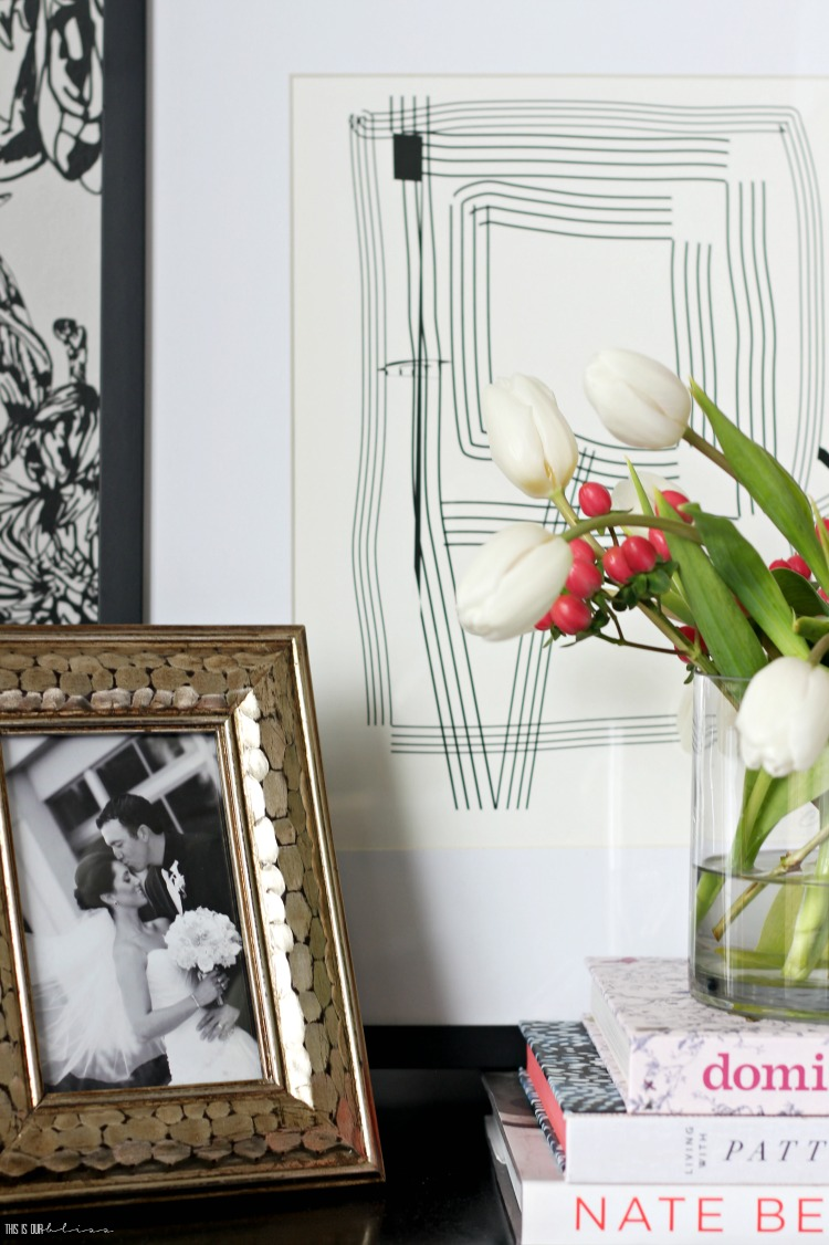 How to do a Mini Spring Refresh in the Bedroom - Nightstand with tulips and leaning art - This is our Bliss