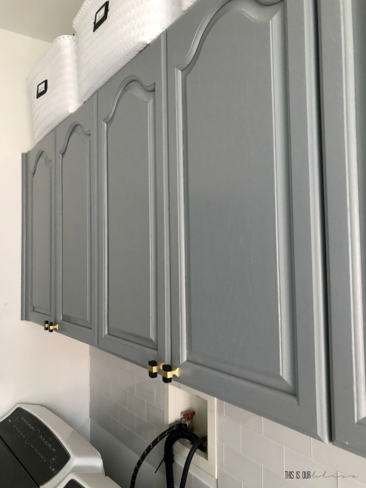 How to Simply Transform your cabinets with paint in a day - gray laundry room cabinets - This is our Bliss