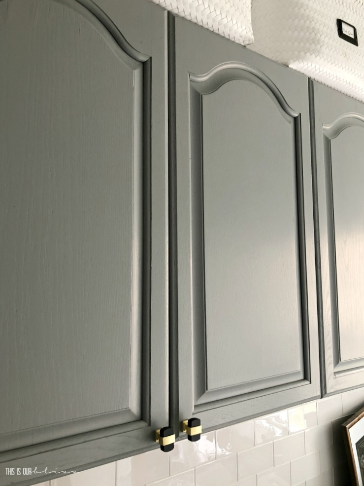 Simply transform your cabinets with paint - gray painted cabinets - laundry room cabinet update with paint - This is our Bliss