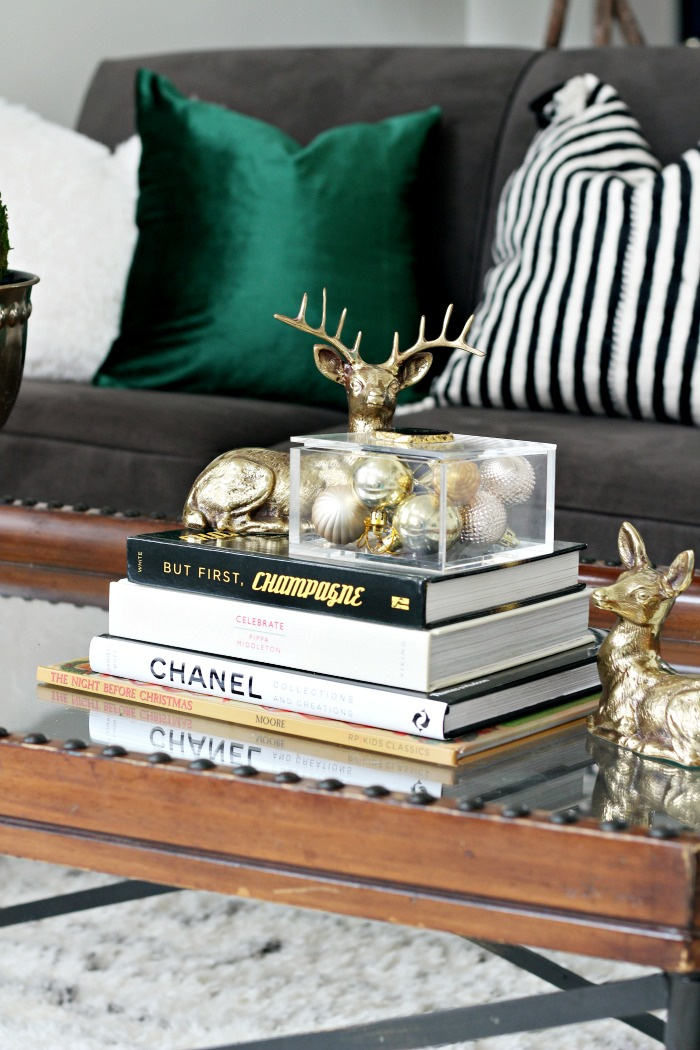 Green Velvet Pillows For Christmas Brass Deer And Coffee Table Books For Simple And Elegant Christmas Decorating This Is Our Bliss This Is Our Bliss